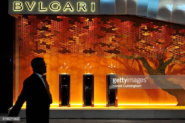 A visitor walks past the Bulgari booth during Baselworld on March 16 2016 in Basel Switzerland Held annually Baselworld is the most important watch...