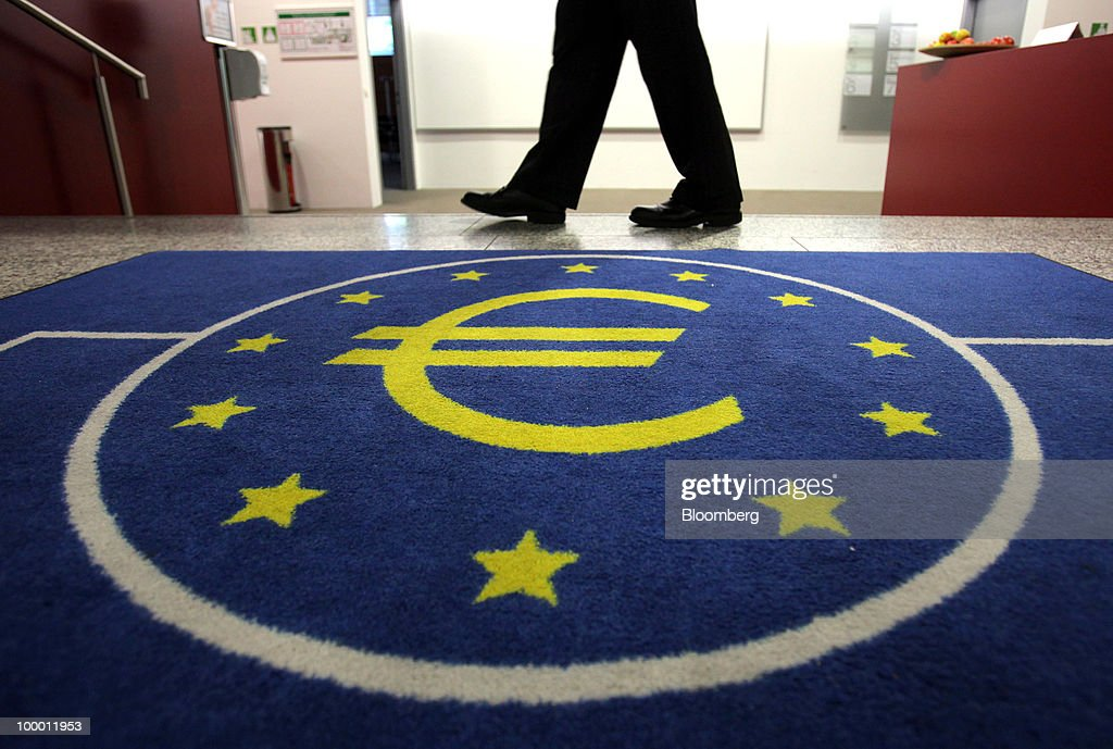 A visitor walks past the European Central Bank (ECB) logo, featuring a euro symbol, in Frankfurt, Germany, on Thursday, May, 20, 2010. Europe's debt crisis will depress the euro still further after it declined to the lowest level since 2006, according to UBS AG and BNP Paribas SA. Photographer: Hannelore Foerster/Bloomberg via Getty Images