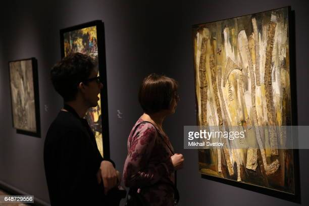 A visitor walks past the PostWar European Art Exhibition at Pushkin Museum in Moscow Russia March 6 2017 The exhibition includes more than 200 works...