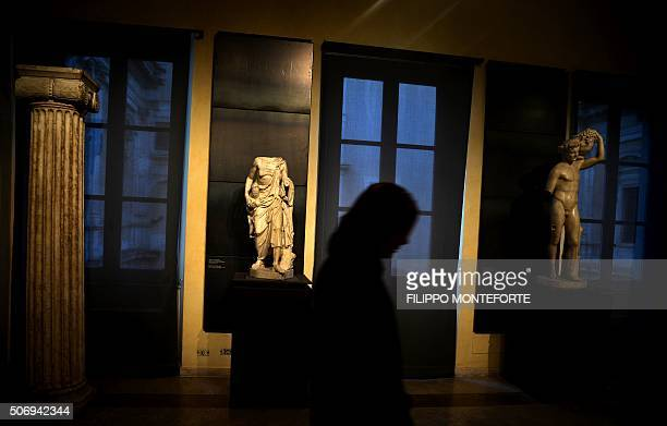A visitor walks past two statues on display at Rome's Capitoline Museum on Capitol Hill on January 26 2016 Italy's desire to court visiting Iranian...
