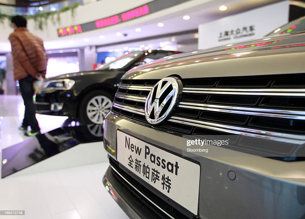 A visitor walks past Volkswagen AG Passat sedans displayed inside the Oriental Pearl Tower in the Pudong area of Shanghai, China, on Wednesday, Jan. 30, 2013. China's economic growth accelerated for the first time in two years as government efforts to revive demand drove a rebound in industrial output, retail sales and the housing market. Photographer: Tomohiro Ohsumi/Bloomberg via Getty Images