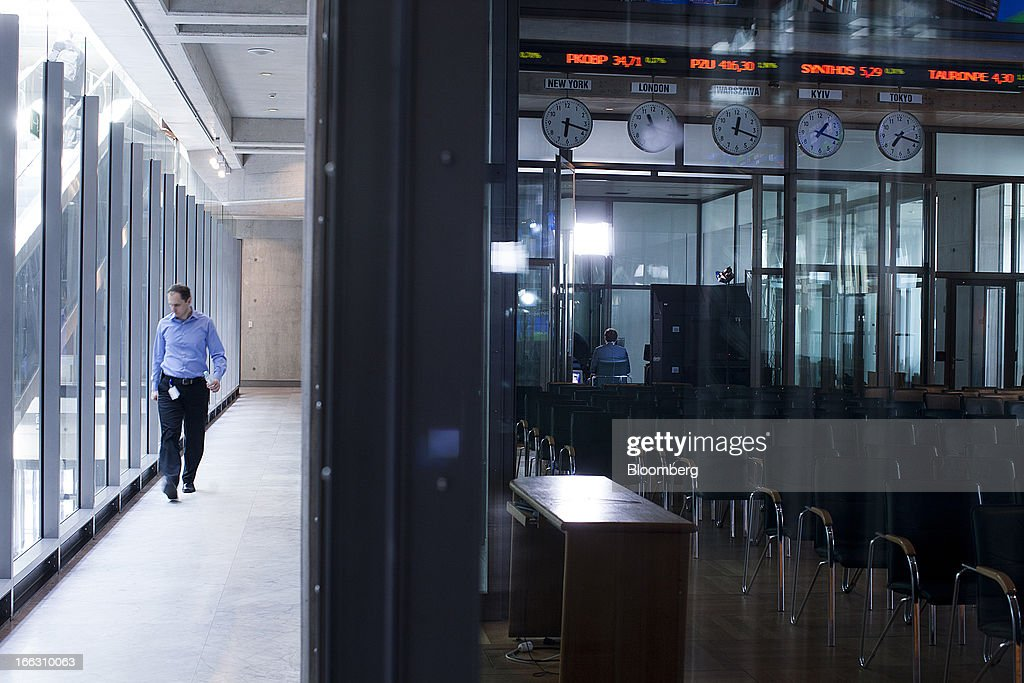 A visitor walks through a corridor at the Warsaw Stock Exchange in Warsaw, Poland, on Thursday, April 11, 2013. Poland's central bank kept interest rates unchanged at a record-low 3.25 percent yesterday. Photographer: Bartek Sadowski/Bloomerg
