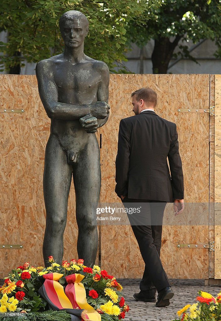 A visitor walks through a memorial to the planners of the 1944 assassination attempt on Adolf Hitler on the 69th anniversary of the failed mission on July 20, 2013 in Berlin, Germany. The leaders of the conspiracy, including Claus Schenk Graf von Stauffenberg, were shot in the courtyard, and the site has been used as a memorial to German resistance during World War II.
