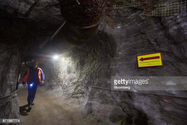 A visitor walks through an access tunnel in the underground potash mine at the Usolskiy Potash Complex operated by EuroChem Group AG at...