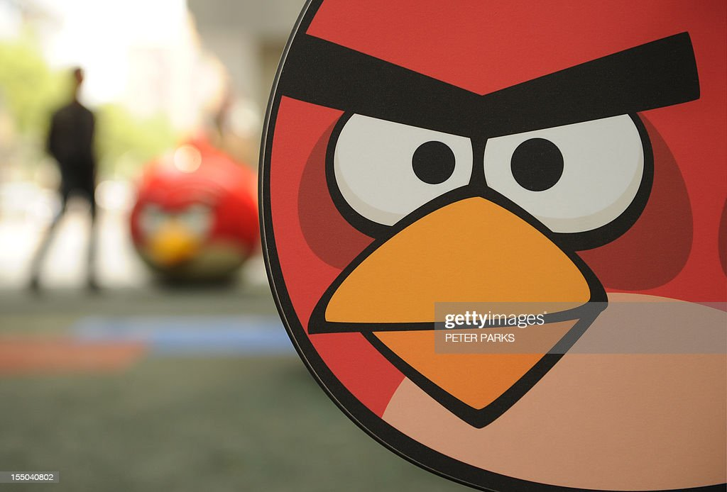 A visitor walks through Shanghai's first Angry Birds Activity Park at Tongji University in Shanghai on October 31, 2012. The creators of the popular game 'Angry Birds', Rovio Entertainment, plans to open its first theme park in Asia by early next year in Haining city, Zhejiang province, which neighbours China's commercial hub of Shanghai, Rovio's General Manager for China Paul Chen told AFP. AFP PHOTO/Peter PARKS