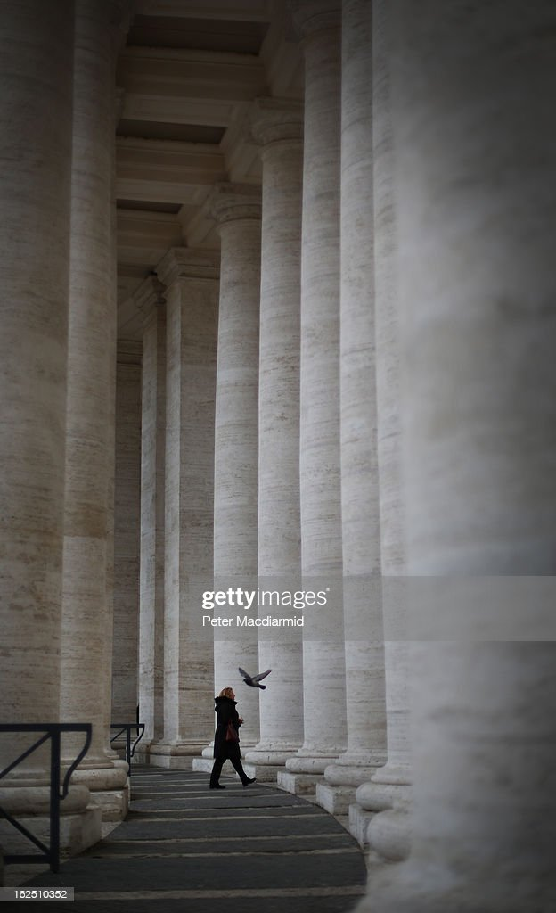 A visitor walks through the Colonnades in St Peter's Square on February 24, 2013 in Vatican City, Vatican. The Pontiff will hold his last weekly public audience on February 27, 2013 before he retires the following day. Pope Benedict XVI has been the leader of the Catholic Church for eight years and is the first Pope to retire since 1415. He cites ailing health as his reason for retirement and will spend the rest of his life in solitude away from public engagements.