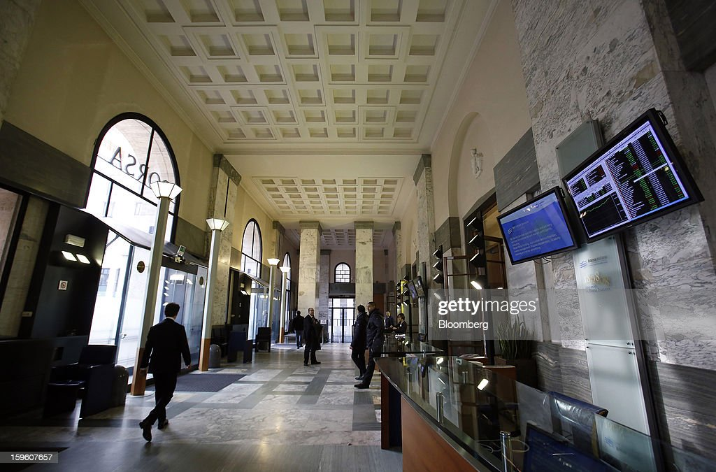 A visitor walks through the entrance hall inside the Borsa Italiana, Italy's stock exchange, which is part of the London Stock Exchange Group Plc, in Milan, Italy, on Thursday, Jan. 17, 2013. The euro-area economy won't return to growth until the next quarter as a recovery in Italy is delayed and France continues to shrink, according to a survey of economists. Photographer: Alessia Pierdomenico/Bloomberg via Getty Images