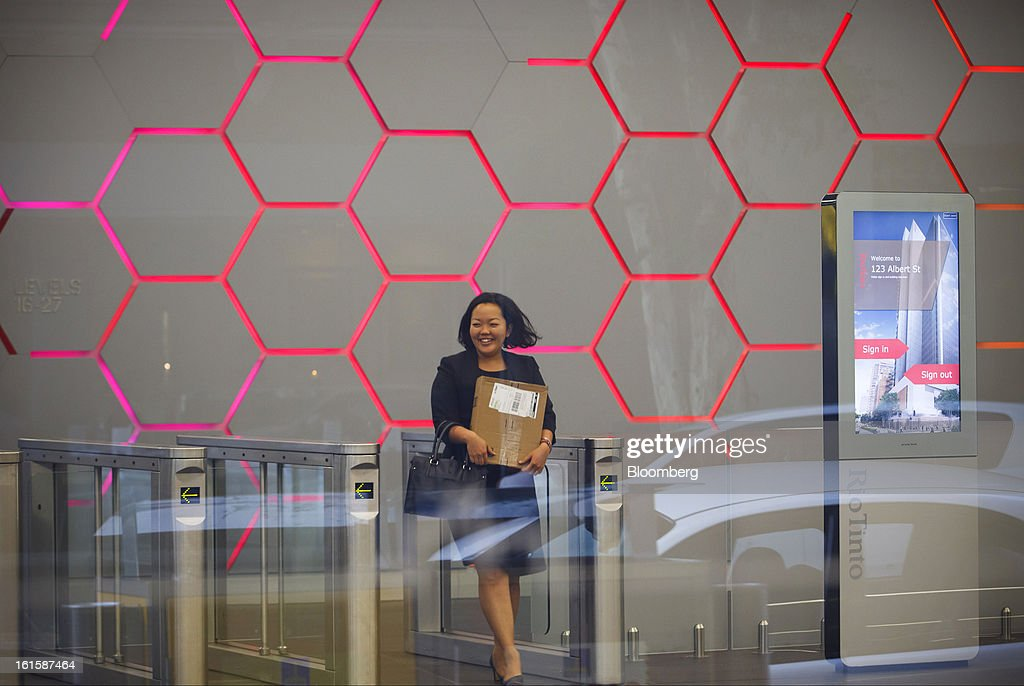 A visitor walks through the foyer of the Rio Tinto Tower, which houses the offices of Rio Tinto Group, in Brisbane, Australia, on Tuesday, Feb. 12, 2013. Rio Tinto, the world's second-biggest mining company, is scheduled to announce full-year earnings on Feb. 14. Photographer: Patrick Hamilton/Bloomberg via Getty Images