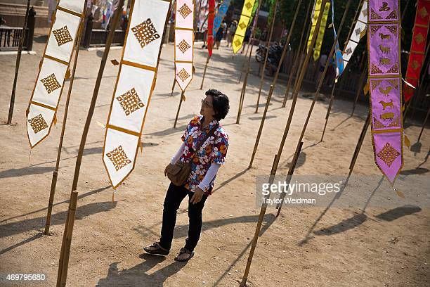 A visitor walks through the grounds of a temple before making an offering for the Songkran festival on April 15 2015 in Chiang Mai Thailand The...