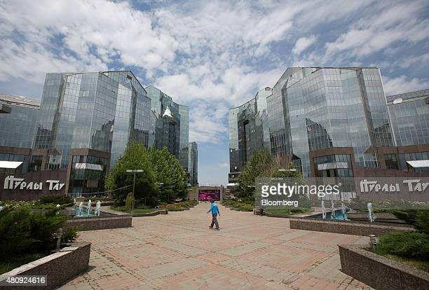 A visitor walks through the grounds of the Nurly Tau business center in Almaty Kazakhstan on Saturday June 27 2015 Almaty with a population of 16...