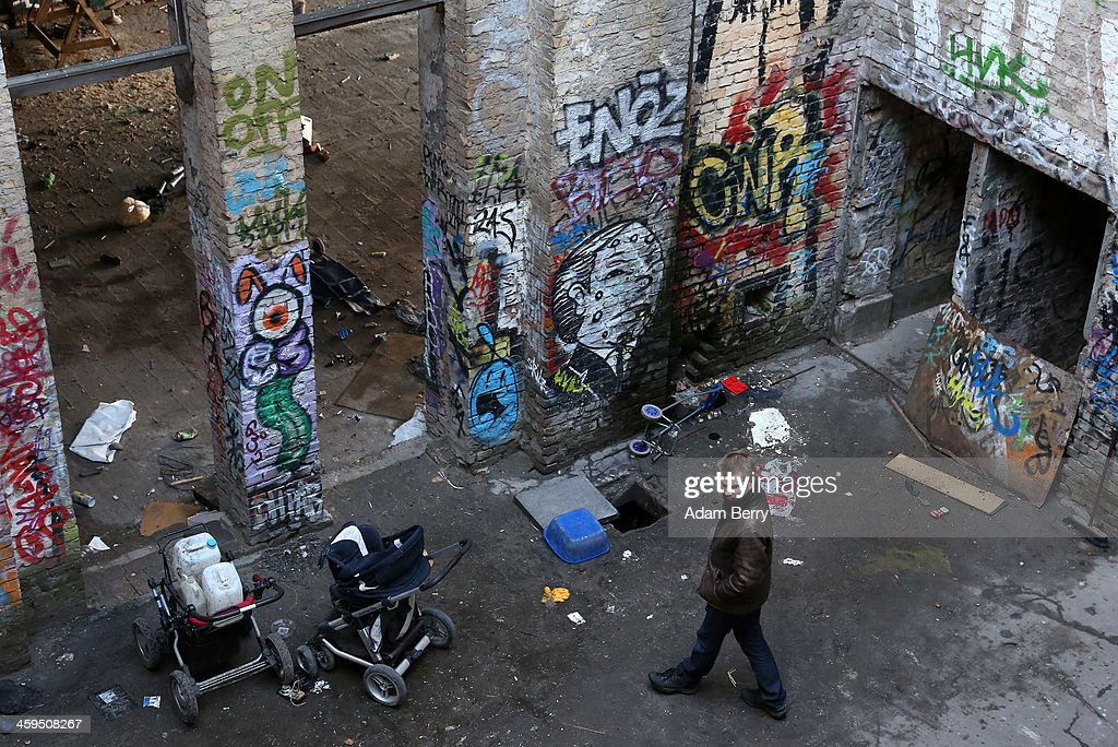A visitor walks through the interior of a former ice factory known locally as the Eisfabrik, currently containing makeshift dwellings for homeless Roma from Bulgaria, on December 27, 2013 in Berlin, Germany. The future of several homeless members of the Roma community, mostly from Bulgaria, remains uncertain as officials decide whether to evict those who have taken up residence over the past two years in the decayed structure. Citizens of Romania and Bulgaria, countries which joined the European Union in 2007, will be granted full access to European job markets next year, which some critics fear may bring about 'welfare tourism,' seeing squats such as those in the Eisfabrik as a warning of what will come if the immigration is unregulated.