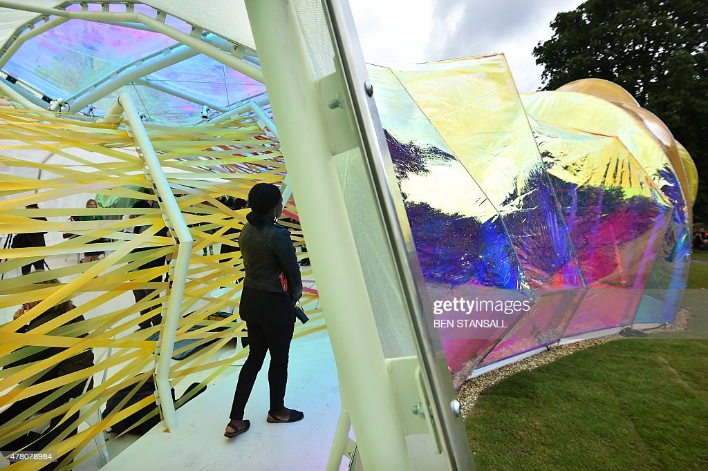 A visitor walks through the Serpentine pavilion structure designed by Spanish architects Lucia Cano and Jose Selgas at the Serpentine Gallery in...