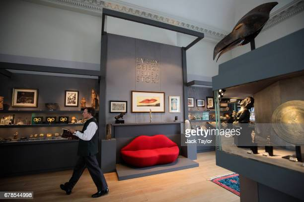 A visitor walks with a catalogue as he views the exhibits from 'Every Object Tells a Story' at 5 Cromwell Place on May 4 2017 in London England...