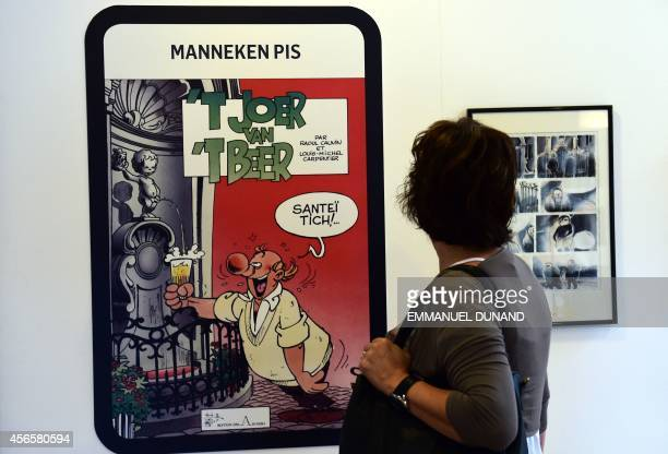 A visitor watches a comics cover by Belgian author Raoul Cauvin and Belgian cartoonist LouisMichel Carpentier in the 'Centre Belge de la Bande...