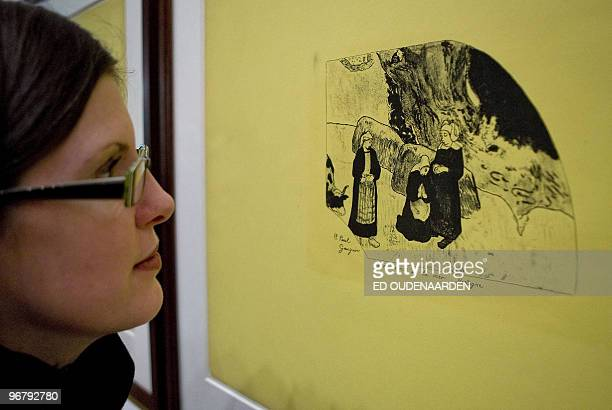 A visitor watches a lithography of the Volpiniserie on February 17 2010 in Amsterdam The Van Gogh Museum in Amsterdam shows works of French paintor...