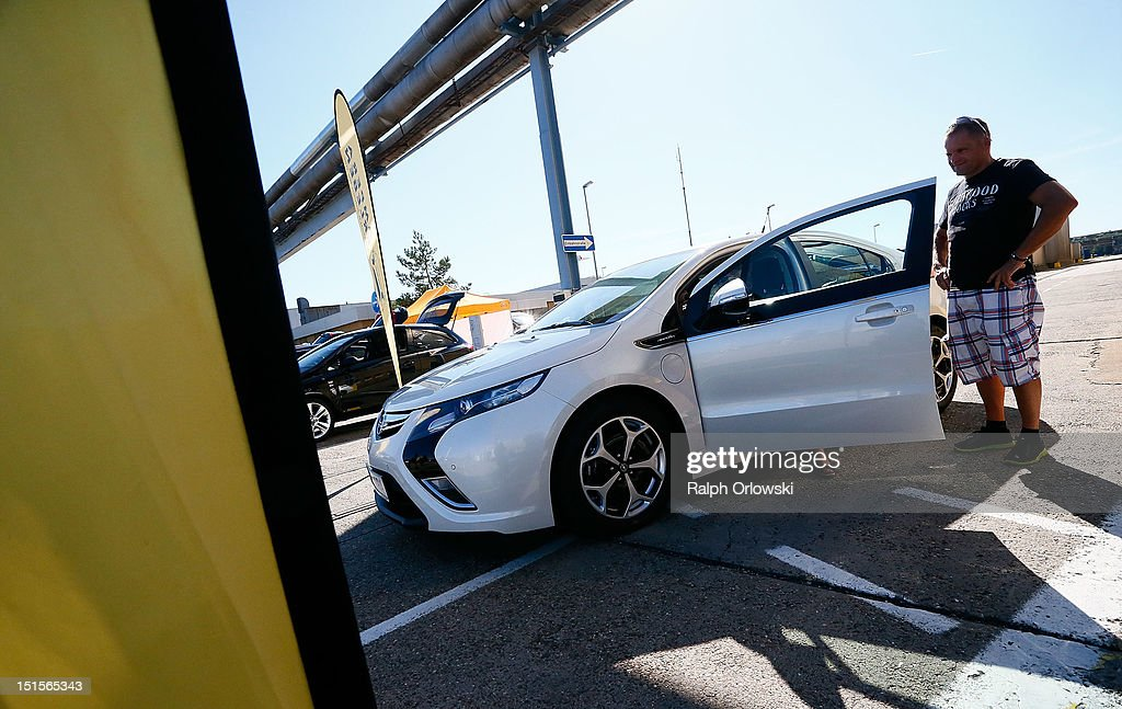 A visitor watches an Opel Ampera at the manufacturing plant of German car maker Adam Opel GmbH on September 8, 2012 in Kaiserslautern, Germany. Automaker Opel, founded in 1862, celebrates their 150th anniversary.
