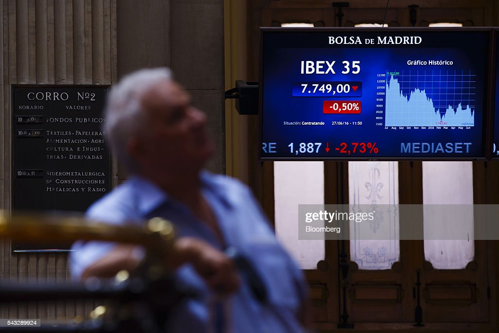 A visitor watches the performance of the Ibex 35 stock index on electronic screens at the Madrid stock exchange, also known as Bolsas y Mercados Espanoles, in Madrid, Spain, on Monday, June 27, 2016. Spanish government bonds jumped, pushing the yield down by the most in eight months, after Acting Prime Minister Mariano Rajoy defied opinion polls to consolidate his position in the country's general election after Brexit rocked the world's financial markets last week. Photographer: Angel Navarrete/Bloomberg via Getty Images