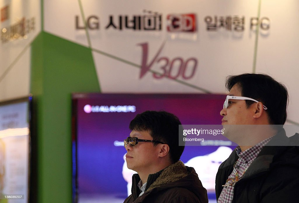 Visitor wearing 3-D glasses look at a LG Electronics Inc. 3-D smart television at the company's showroom in the COEX mall in Seoul, South Korea, on Wednesday, Feb. 1, 2012. LG Electronics Inc., South Korea's second-largest electronics maker, posted the first profit at its handset business in seven quarters, helping shares reverse earlier losses in Seoul trading. Photographer: SeongJoon Cho/Bloomberg via Getty Images