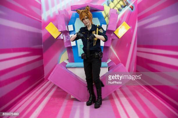 A visitor wearing a cartoon character costume poses during the C3AFA event in Jakarta Indonesia on 19 August 2017 C3AFA is 6th Japanese popculture...