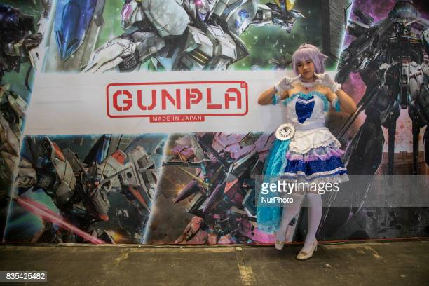 A visitor wearing a cartoon character costume poses during the C3AFA event in Jakarta Indonesia on 19 August 2017 The scale has expanded to the...