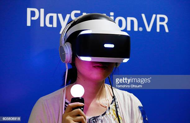 A visitor wearing a Sony Interactive Entertainment Inc PlayStation VR headset plays a video game at the Tokyo Game Show 2016 on September 15 2016 in...