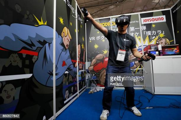 A visitor wearing a VR headset plays a video game in the PRODIGY Co Ltd booth during the Tokyo Game Show 2017 at Makuhari Messe on September 21 2017...