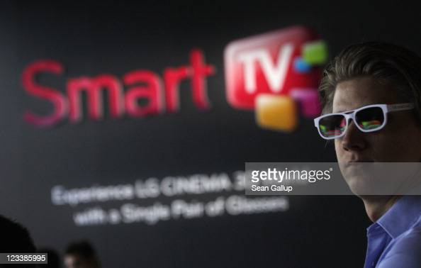 A visitor wears 3D glasses while watching a presentation of 3D Smart TV at the LG stand at the IFA 2011 consumer technology trade fair on the first...
