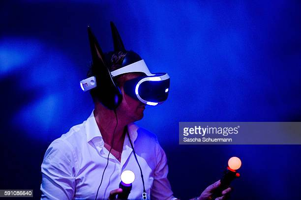 A visitor wears a virtual reality glasses at the Gamescom 2016 gaming trade fair during the media day on August 17 2016 in Cologne GermanyGamescom is...