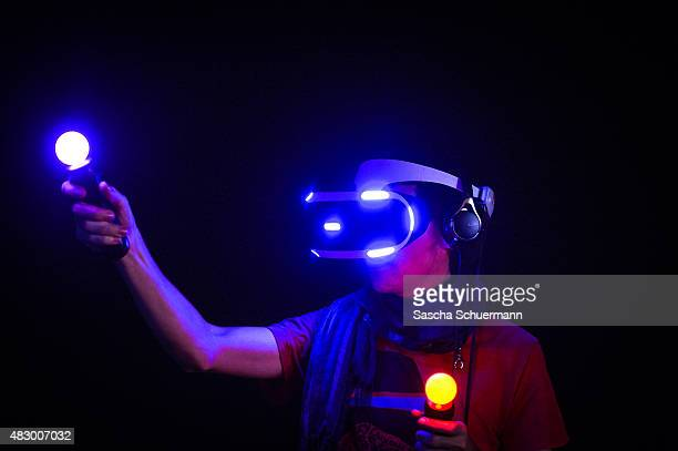 A visitor wears a virtual reality glasses the Sony Morpheus at the Gamescom 2015 gaming trade fair during the media day on August 5 2015 in Cologne...