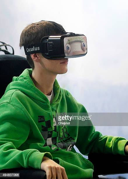 A visitor wears a virtual reality headmounted 'Oculus Rift' as she tests the 'Lapins Cretin VR Ride' a virtual reality ride developed by Ubisoft at...