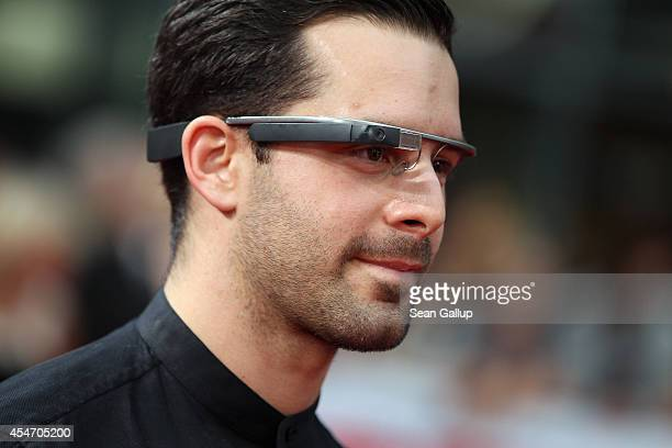 A visitor wears Google Glass as he arrives for the German premiere of the film 'Sex Tape' at CineStar on September 5 2014 in Berlin Germany