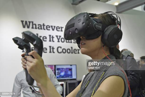 A visitor wears the HTC Vive visual reality headset during the annual Computex computer exhibition in Taipei on May 31 2016 More then 5000 booths...