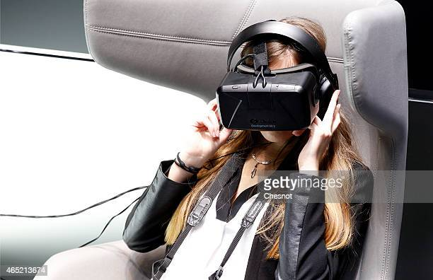 A visitor with a virtual reality headmounted 'Oculus Rift' is seen during the press day 85th Geneva International Motor Show on March 4 2015 in...