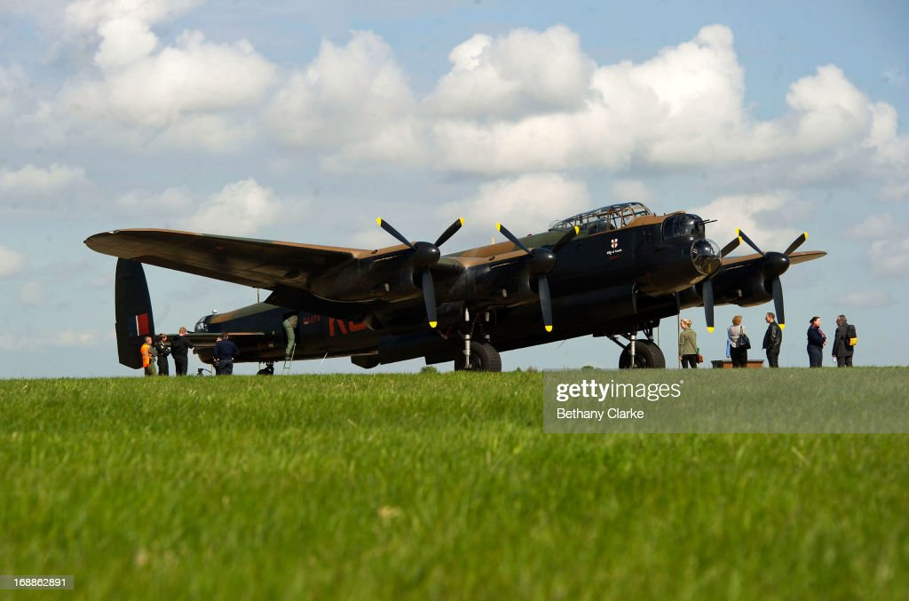 Visitors admire a WWII Lancaster bomber before it takes off from RAF Scampton on May 16, 2013 in Lincoln, England. Ladybower and Derwent reservoirs were used by the RAF's 617 Squadron in 1943 to test Sir Barnes Wallis' bouncing bomb before their mission to destroy dams in Germany's Ruhr Valley. Today marks the 70th anniversary of the famous Dambuster mission and will be watched by veterans from the original campaign.