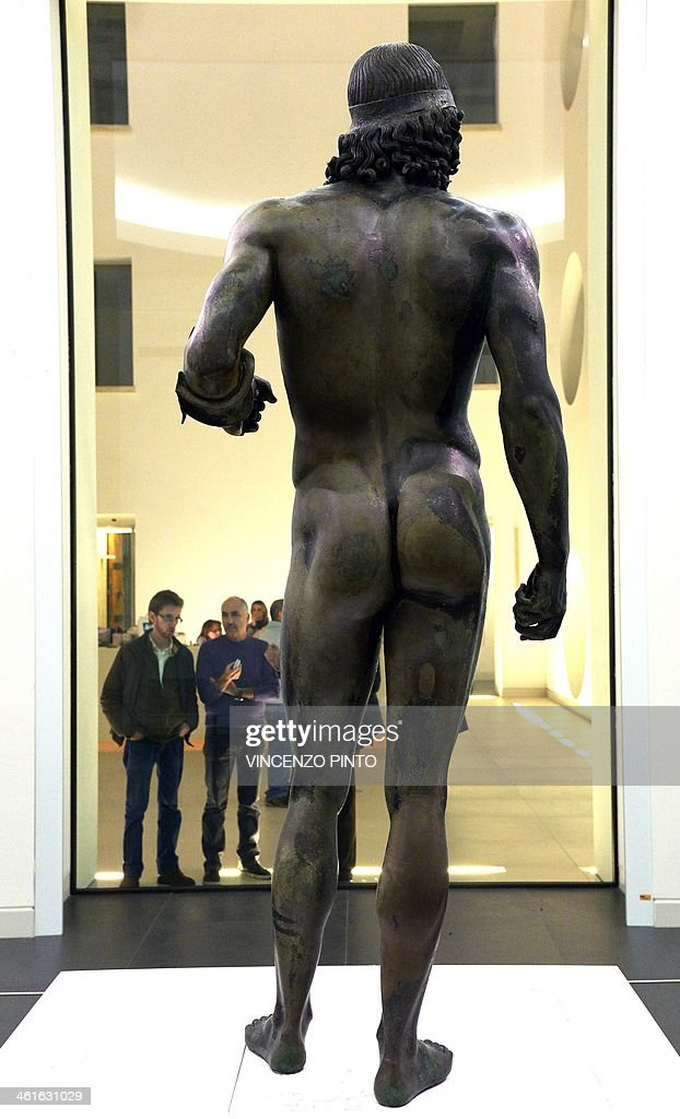 Visitors admire the 2500yearold Riace Bronzes displayed in a renovated Reggio Calabria National Archeological Museum on January 9 following four...