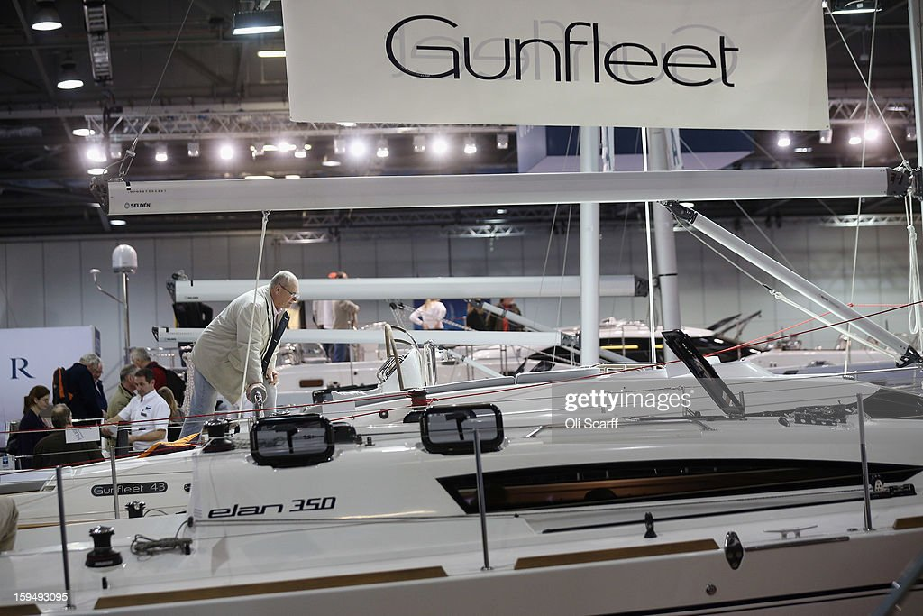 Visitors admire the boats on display at the 2013 London Boat Show, held at the ExCeL Centre, on January 14, 2013 in London, England. Until January 20, 2013 the London Boat Show will showcase, demonstrate and sell maritime equipment ranging from luxury yachts to dinghies.