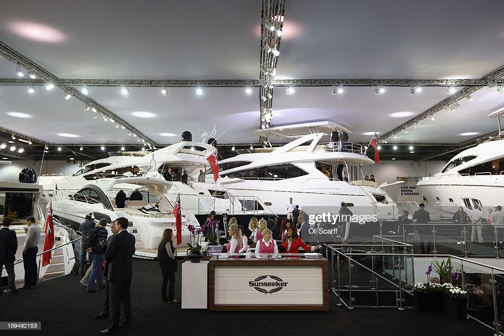 Visitors admire the boats on display on the Sunseeker stand at the 2013 London Boat Show, held at the ExCeL Centre, on January 14, 2013 in London, England. Until January 20, 2013 the London Boat Show will showcase, demonstrate and sell maritime equipment ranging from luxury yachts to dinghies.