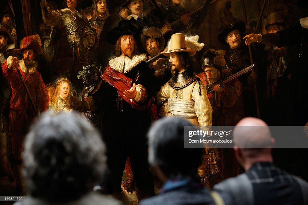 Visitors admire The Nightwatch by Rembrandt four days after the Rijksmuseum Official Opening on April 17, 2013 in Amsterdam, Netherlands. The 10-year renovation of the Rijksmuseum is one of the most significant ever undertaken by a museum. The entire building has been renewed – the historic 19th-century building has been transformed and new public facilities have been created including a spectacular new entrance hall, a new Asian pavilion and renovated gardens. The museum features over 8,000 works of art and artefacts telling the story of 800 years of Dutch art and history, from the Middle Ages to the present day. The world-famous collection, including masterpieces by artists such as Frans Hals, Jan Steen, Johannes Vermeer and Rembrandt van Rijn, have been presented in chronological sequence for the first time, creating an awareness of time and a sense of beauty.