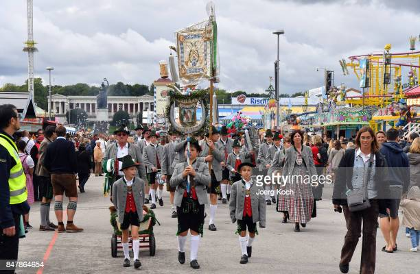 Visitors and a bavarian brass band attend the first day of the 2017 Oktoberfest beer fest on September 16 2017 in Munich Germany Oktoberfest is the...