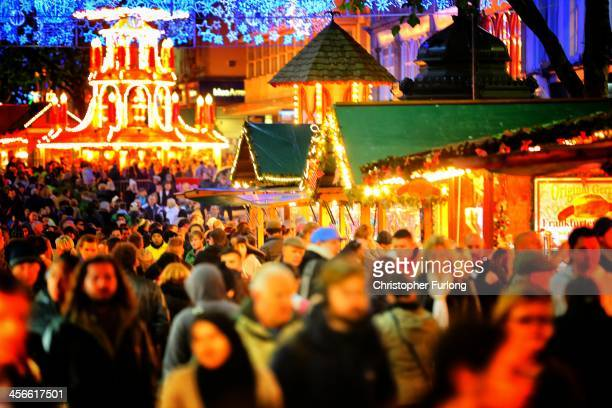 Visitors and Christmas shoppers enjoy Birmingham's Frankfurt Christmas market on December 3 2013 in Birmingham England Birmingham's Frankfurt...