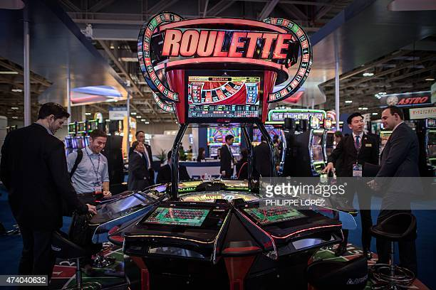 Visitors and exhibitors are seen at the Global Gaming Expo Asia in the world's biggest gambling hub of Macau on May 20 2015 The threeday fair of...