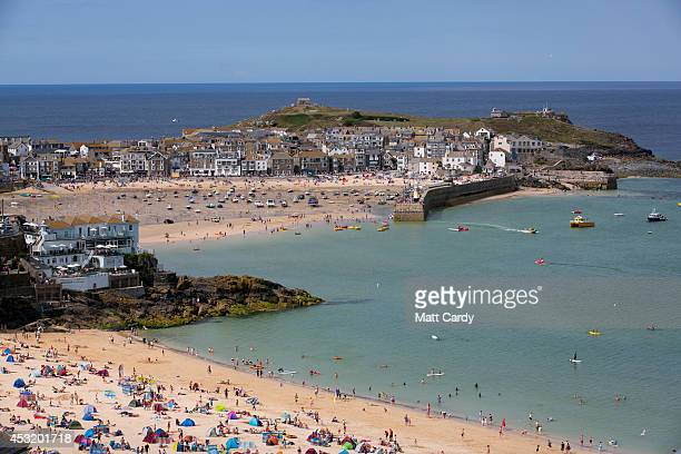 Visitors and holidaymakers enjoy the fine weather as they gather on the beaches and the harbour on August 4 2014 in St Ives Cornwall England A recent...