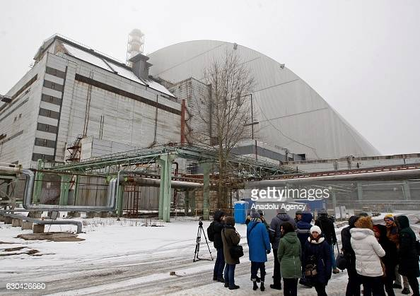 Visitors and journalists near new protective shelter over the nuclear reactor Unit 4 at Chernobyl nuclear power plant in Chernobyl Ukraine on...