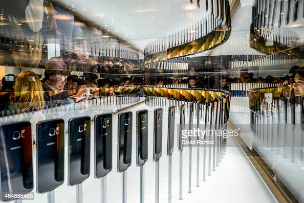 Visitors and journalists take pictures of the new Samsung Galaxy S6 during the Mobile World Congress 2015 March 1 2015 in Barcelona Spain The annual...