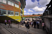 Visitors and staff walk through the grounds on day five of the 2014 Wimbledon Championships at The All England Tennis Club in Wimbledon southwest...