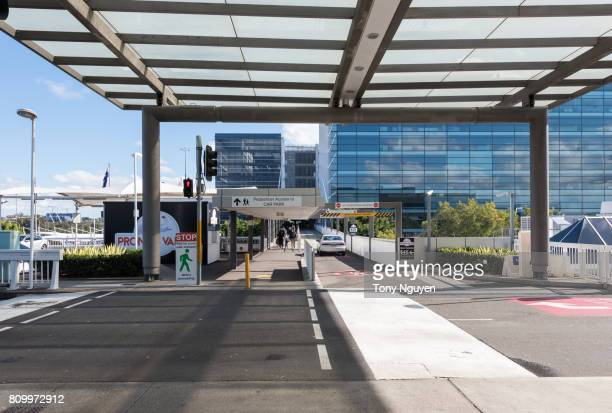 Sydney, Australia - June 13, 2017: Visitors and their family going from Car Park to departure area of Sydney International Airport in a sunny day.