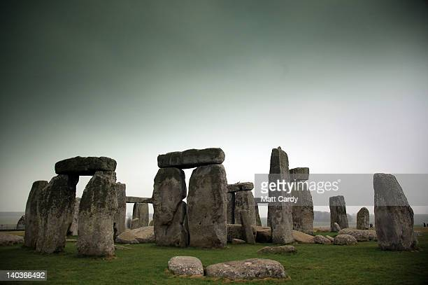 Visitors and tourists walk around the ancient monument at Stonehenge on March 2 2012 in Wiltshire England The English Heritage managed prehistoric...
