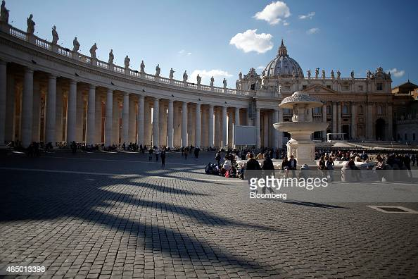 Visitors and tourists walk near the Basilica in St Peter's Square in Vatican City on Tuesday Feb 17 2015 Pope Francis the leader of the world's 12...