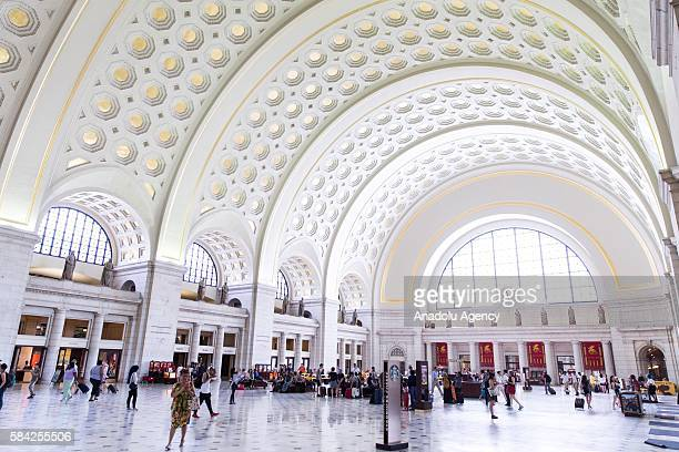 Visitors and travelers move through the Main Hall of Union Station in Washington USA on July 28 2016