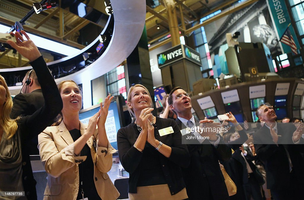 Visitors applaud on the floor of the New York Stock Exchange at the closing bell on July 13, 2012 in New York City. The Dow Jones Industrial Average rallied July 13, closing up almost 204 points to finish at 12,777. The rally ended a 6-day slump, the longest since mid-May.